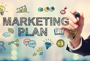 Businessman drawing Marketing Plan concept